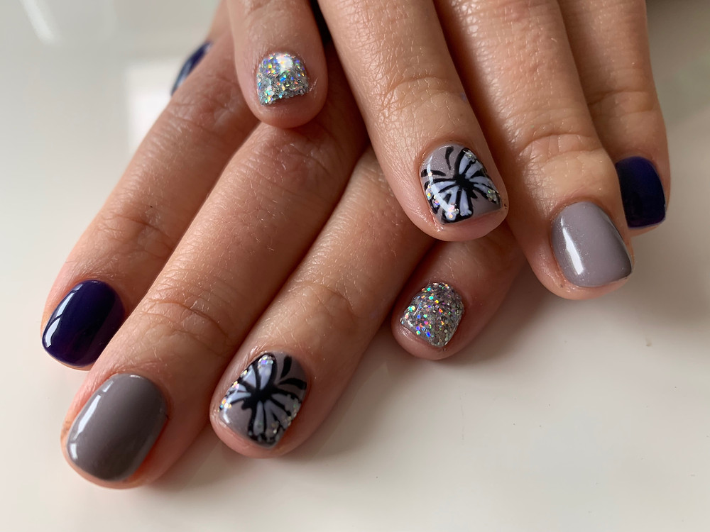 butterfly and glitter manicure by lg nails london