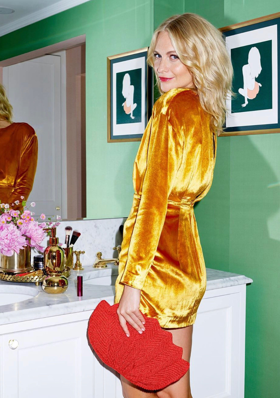 Poppy delevingne standing in bathroom with gold velvet h&m dress
