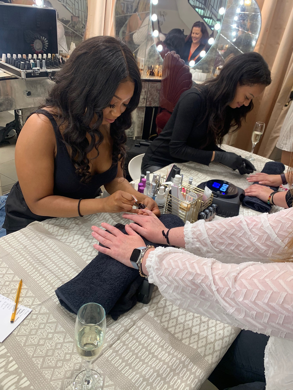 two manicurists painting nails at the charlotte tilbury london makeup store