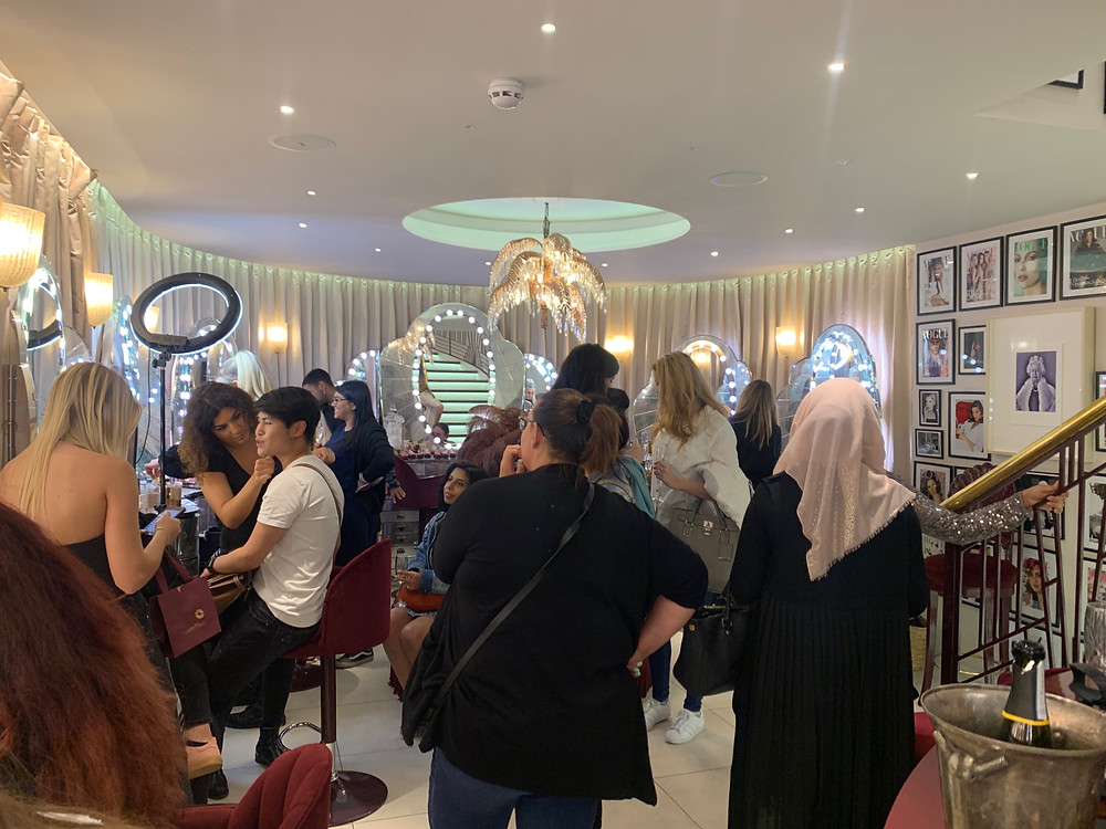 busy store full of women at the charlotte tilbury covent garden london store makeup event