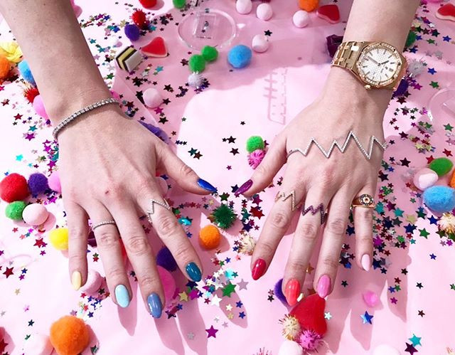 Rosie Fortescue hand models her rainbow nails by LG Nails London wearing rosie fortescue jewellery