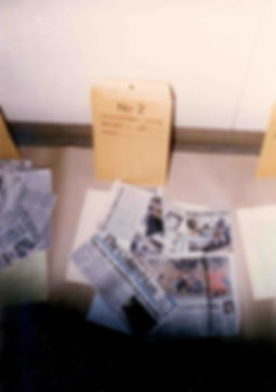 Newspaper clippings in Dodd's apartment about  the Iseli slaying.
