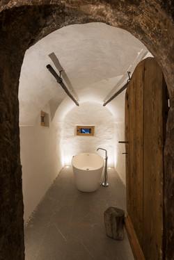 Bathtub in vaulted room