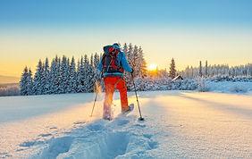 Snowshoe walker running in powder snow w