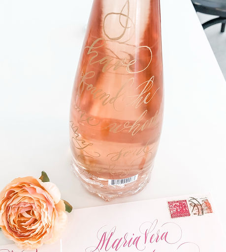 Engraved wine bottle and envelope calligraphy