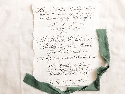 Handwritten wedding invitation on handmade paper