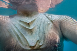 Floating With A Bronze Breast Plate