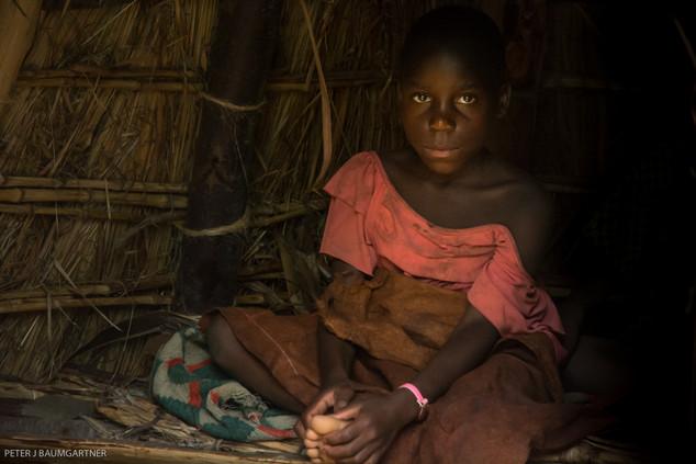 Batwa Girl In Hut