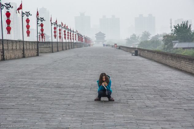 Texting On The Xian City Wall