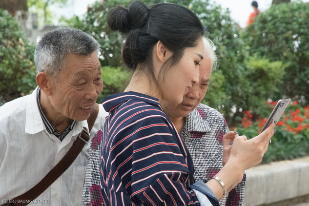 Chinese Family And A Smartphone