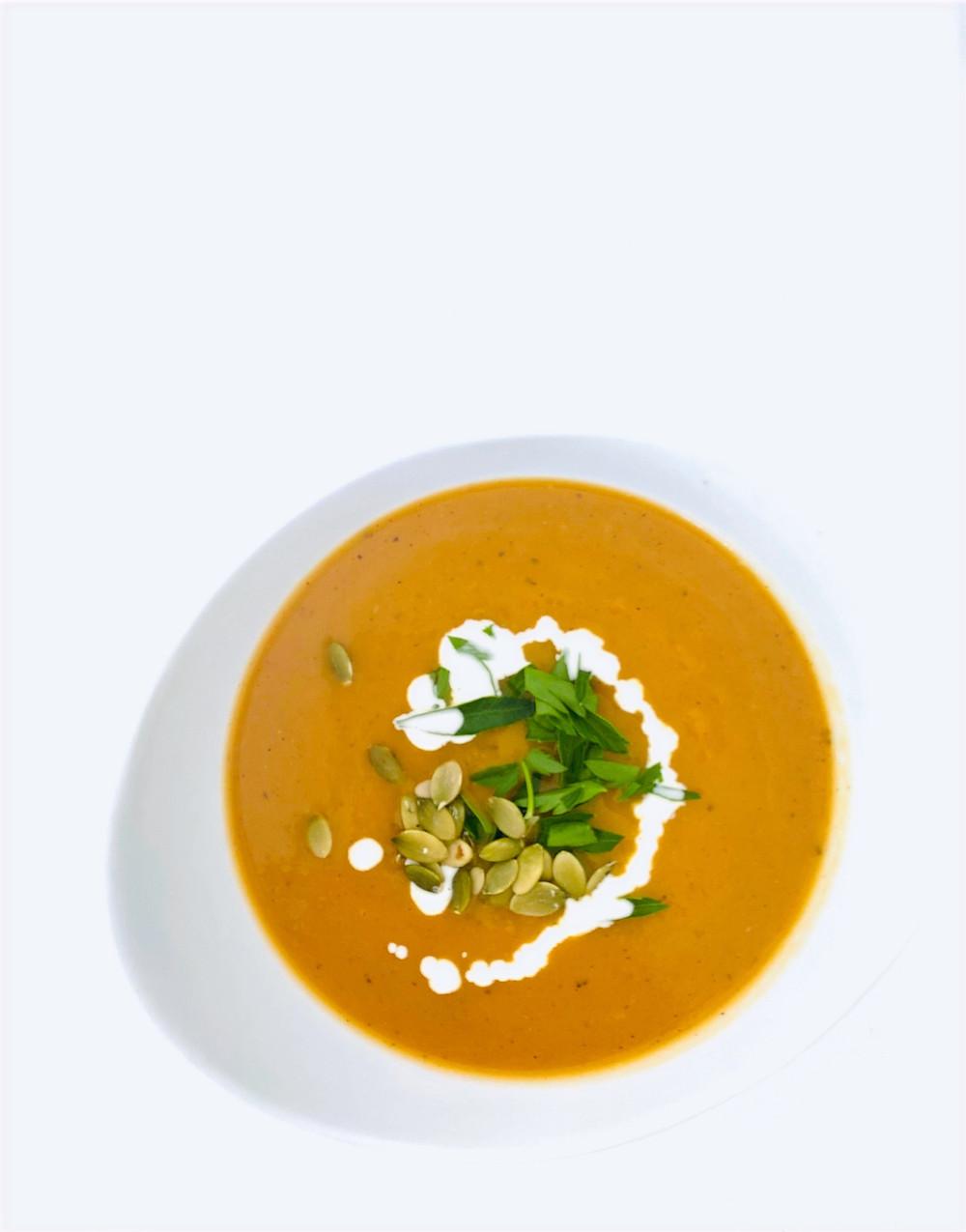 Butternut Squash Apple Soup in a white bowl