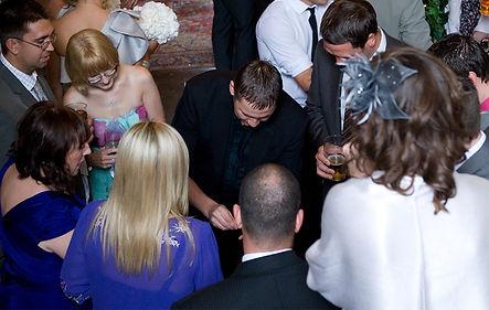 Close-up magic at a wedding reception
