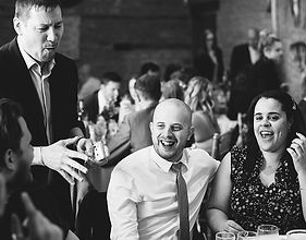 Wedding guests being entertainer durin dinner by magician Dorian