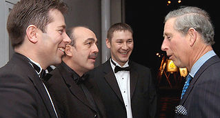 Dorian meeting HRH Prince Charles at a London event.