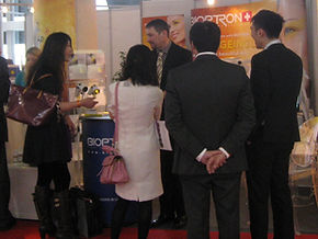 Dorian at trade show stand in Monte Carlo