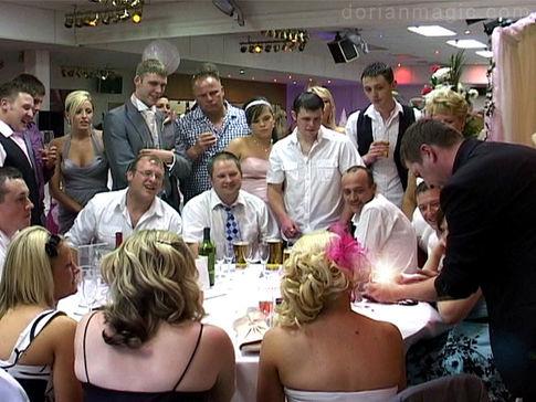 Wedding Magician. 21 guests around a table enjoying Dorian's act at a wedding in Glyn Clydach Hotel, Neath.