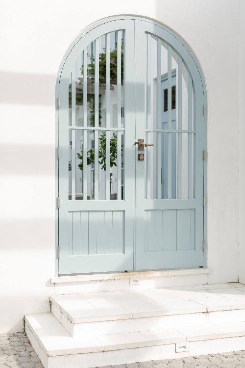 Blue slatted door guarding intellectual property