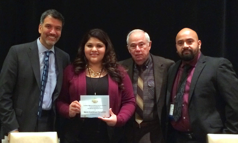 Mitcham Scholarship recipient Maria (center) with NMSHSA Executive Director, Board President and Vice-President.