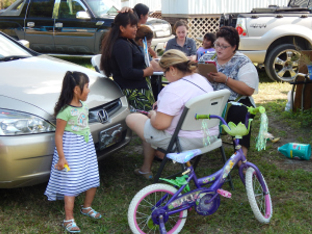 ECMSHP staff visit farmworker families in Florida to find Head Start eligible families.