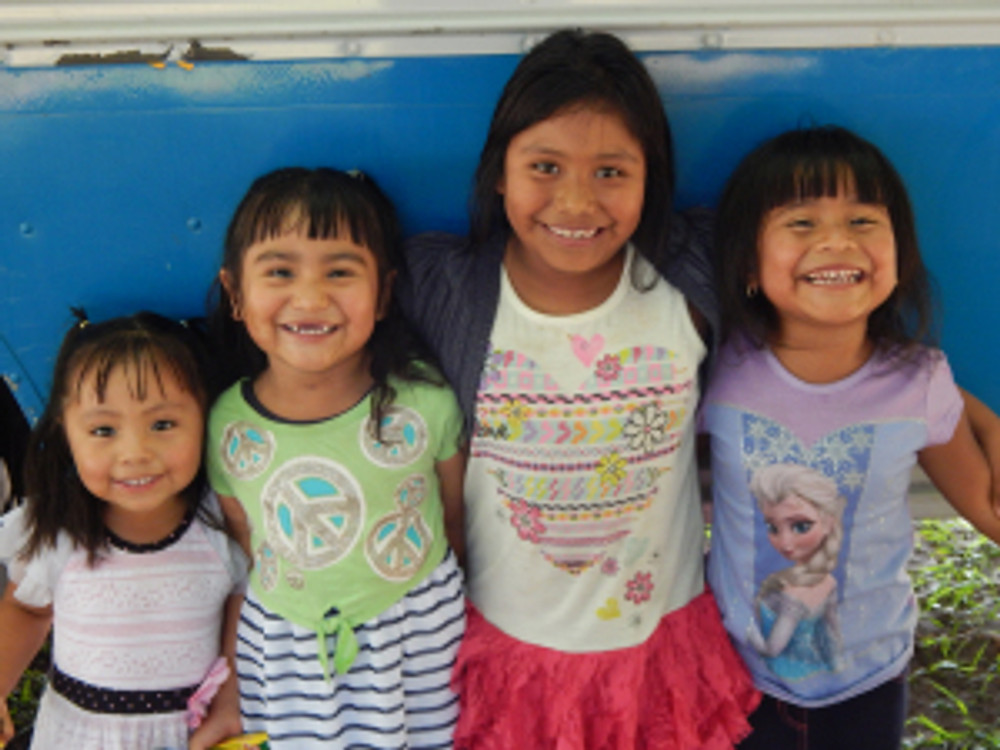 While their parents work in the fields, ECMHSP provides these smiling children high-quality Head Start services.