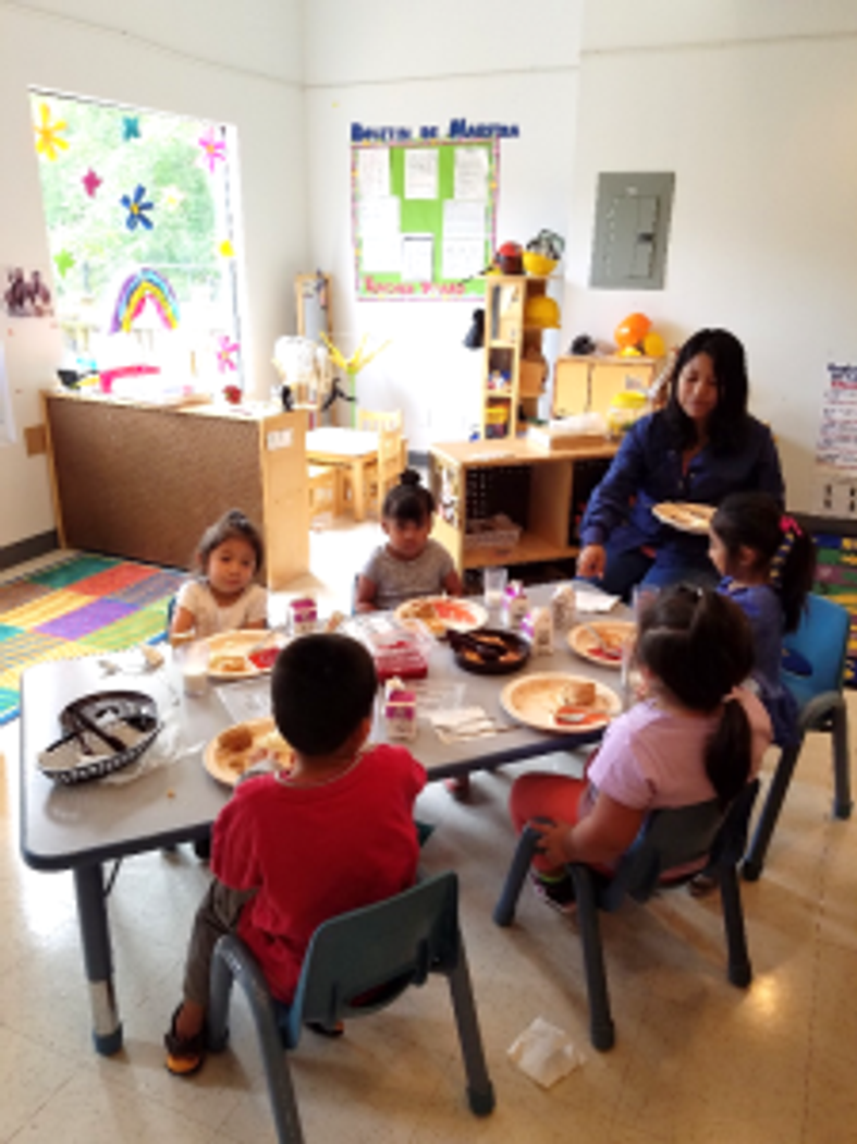 Children enjoy delicious and healthy snacks prepared by our kitchen staff.