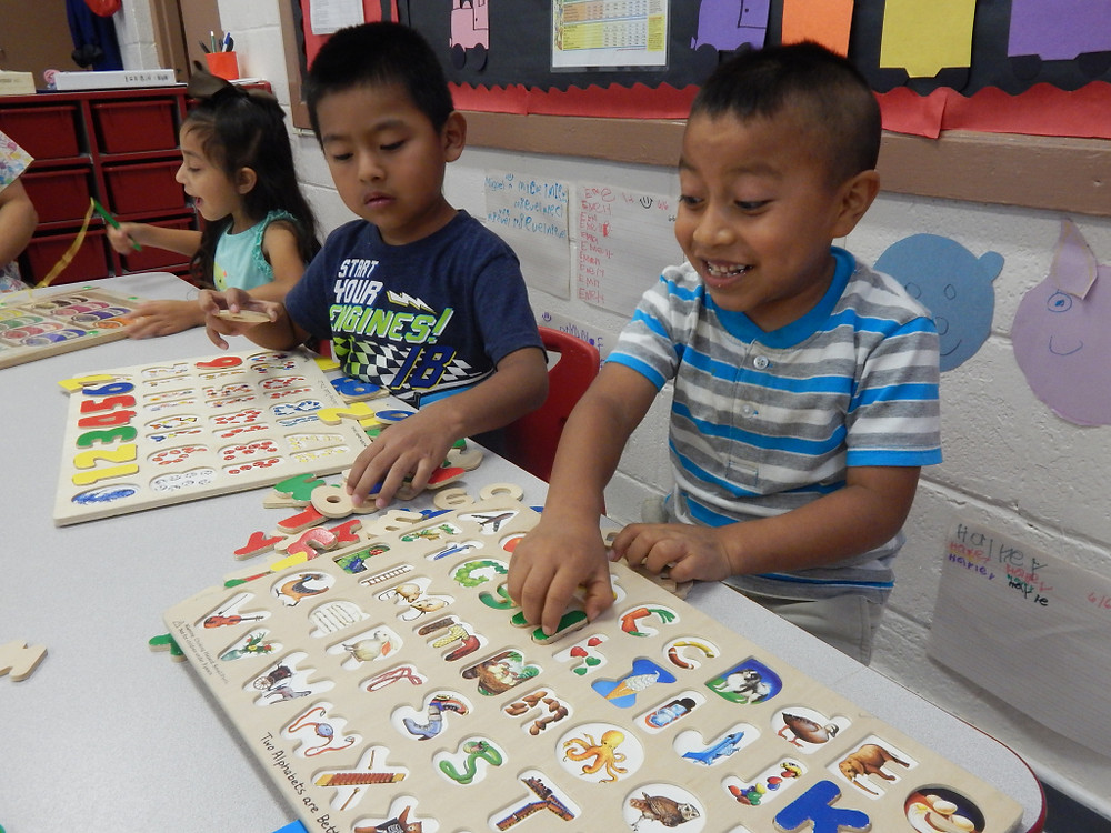 Children learn and play at the St. Helena center while their parents work in the fields.