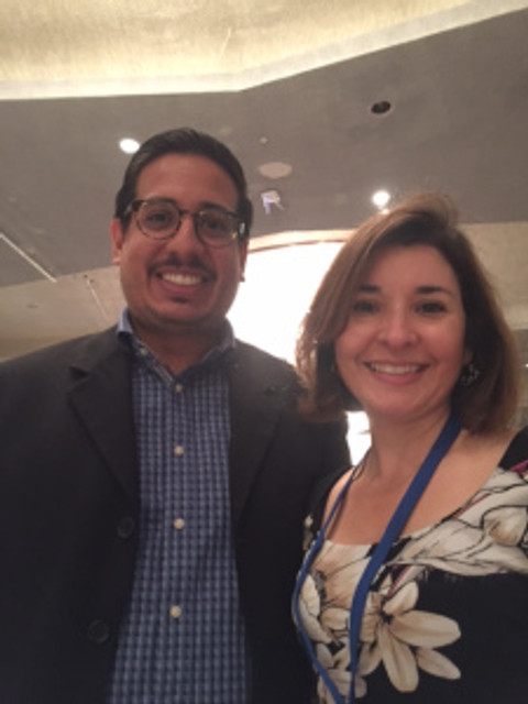 Mercedes Hernández, the Child and Family Health Manager at East Coast Migrant Head Start Project, poses with presenter Ricardo Garay, Health Network Manager for the Migrant Clinicians Network.