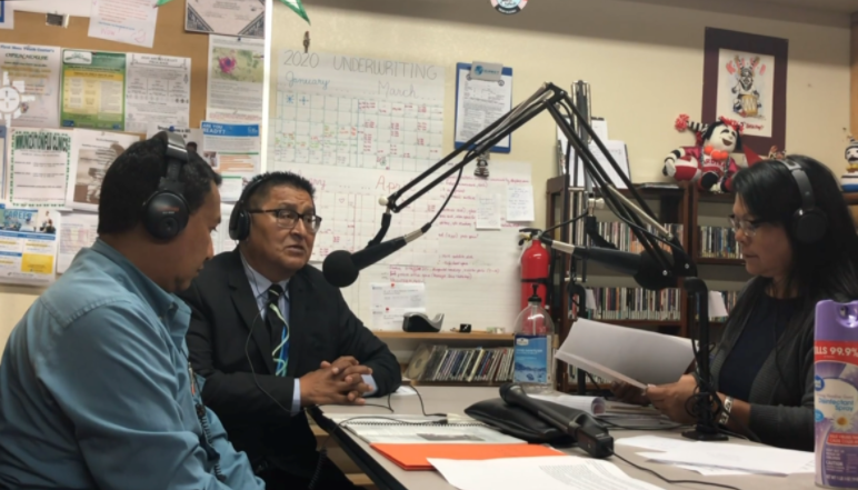 Indian Country Today Editor Patty Taalahongva, right, interviews Hopi Health Care Center Clinical Director Dr. Darren Vicente and Hopi Tribal Vice Chairman Clark Tenakhongva in KUYI's studio. Credit Current Media