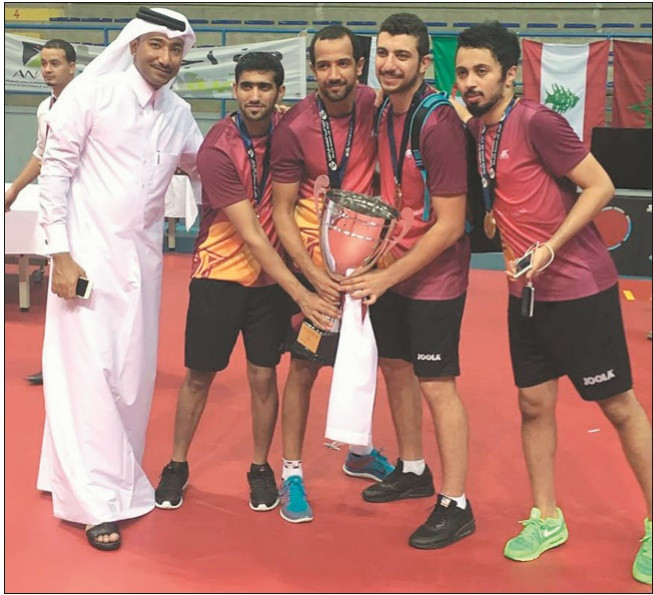 The victorious Qatar men's table tennis team with the trophy after their victory in Hammamet, Tunisia