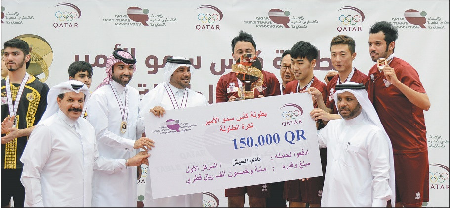 QTTA President Khalil Ahmed al Mohannadi (front right) with other officials present the trophy and the prize money to El Jaish Club after their Emir Cup's victory at the Indoor Hall of Al Arabi Club in Doha on Sunday.