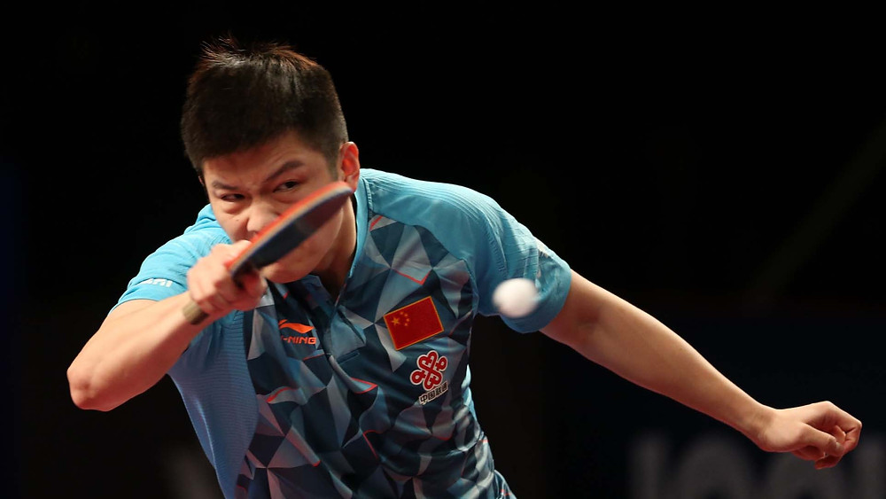 Fan Zhendong severely examined by Fang Bo (Photo: Hussein Sayed)
