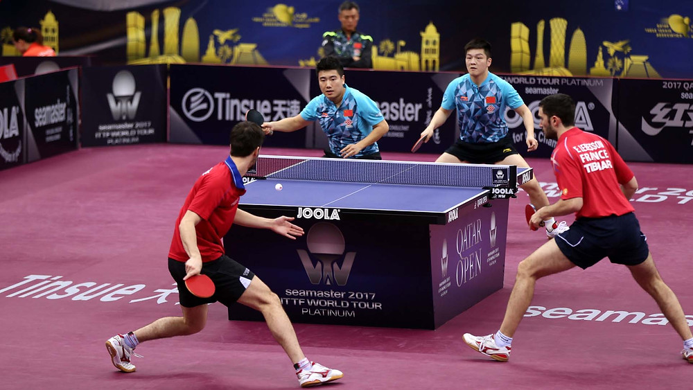 Tristan Flore (left) and Emmanuel Lebesson (right) en route to success against Liang Jingkun far side (Liang Jingkun (left) and (right) Fan Zhendong (Photo: Hussein Sayed)