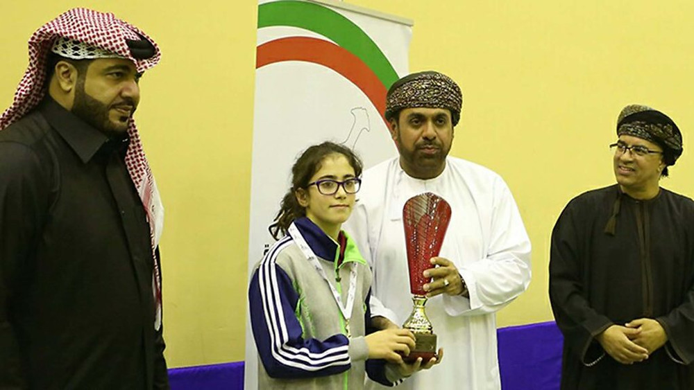 Abdullah Ba Mukhalef presents the Girls' Singles trophy to Talia Azar, (far left) Ali Sultan Almuftah (far right) Fahed Al-Raesi (Photo: courtesy of Mohamed Atoum)