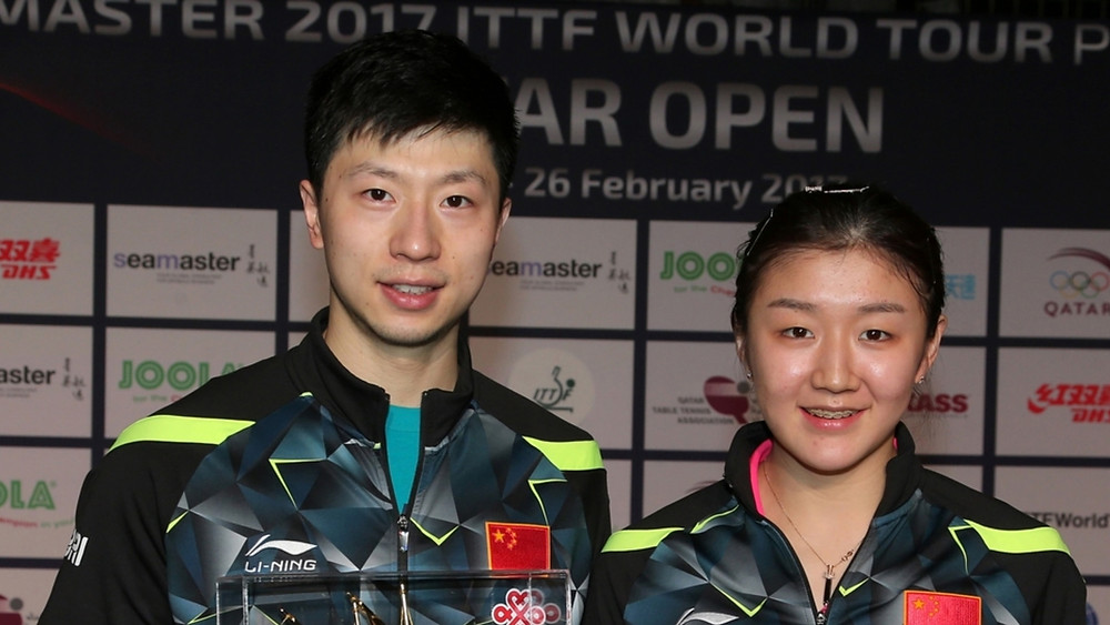 The victorious Men's and Women's Singles champions Ma Long and Chen Meng (Photo: Hussein Sayed)