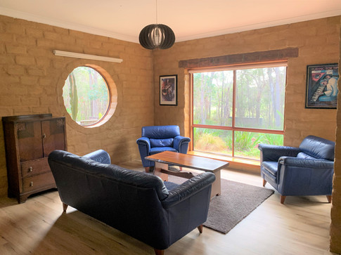 Driftwood lounge room forest view.jpg