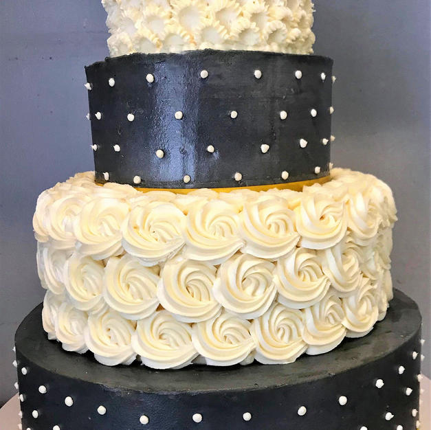 Rosettes and Swiss Dots Wedding Cake.jpg