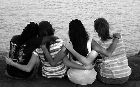 4 girls sitting by water_edited.jpg