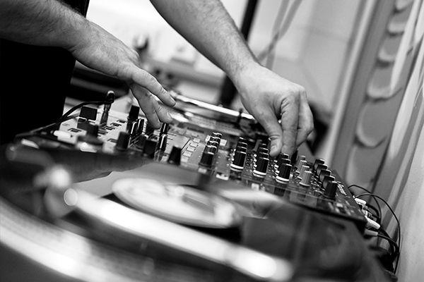DJ DJing on Pioneer DJM and Turntables