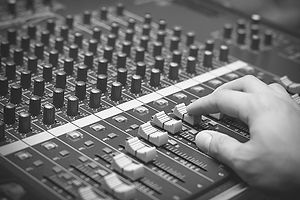 Mixing engineer on mixing desk