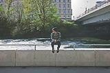 Guy sitting on bridge