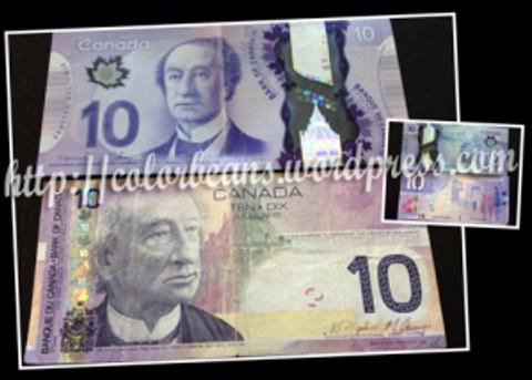 加幣10元 (上面是最新版鈔票,下面就是上一版的紙鈔)
