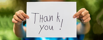 boy_holding_thank_you_sign_TopOfPage-2.j