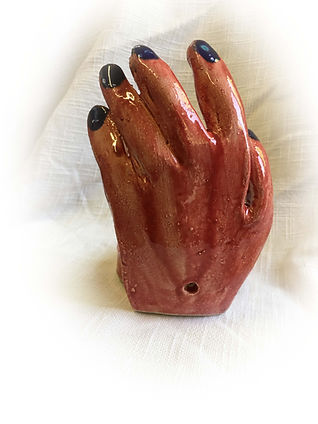 Back of red hand for jewelry or candle h
