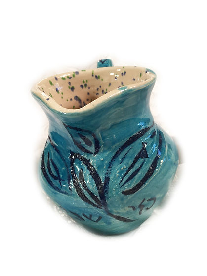 slip trailed blue jug with speckled insi