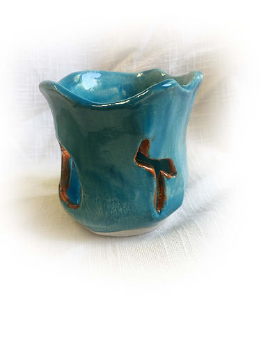 Candle Cup with zachor cur outs blue 1 c
