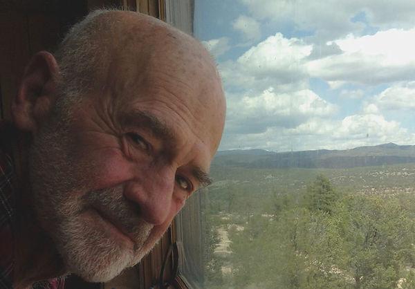 Fred R. Kline by window at ranch-Angela