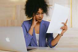 woman-in-blue-blazer-holding-white-paper