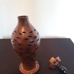 Banksia Nut vase with metal finial $50.00