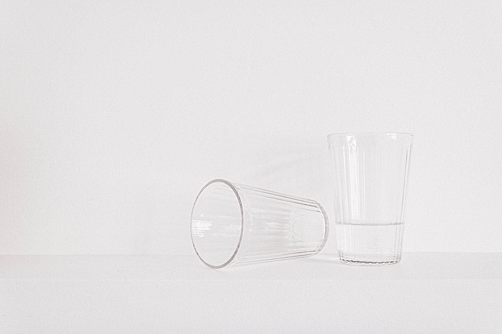 Canva - Two Clear Drinking Glasses on Ta