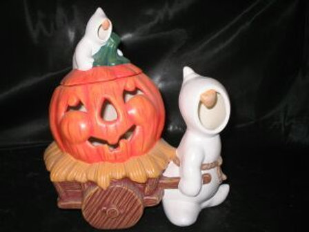 Ghost pulling pumpkin on wagon